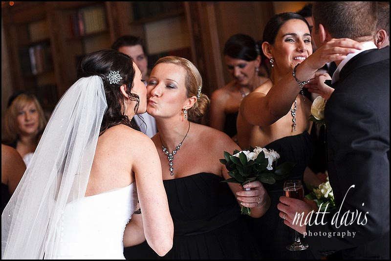 candid photography at Dumbleton Hall after the wedding ceremony