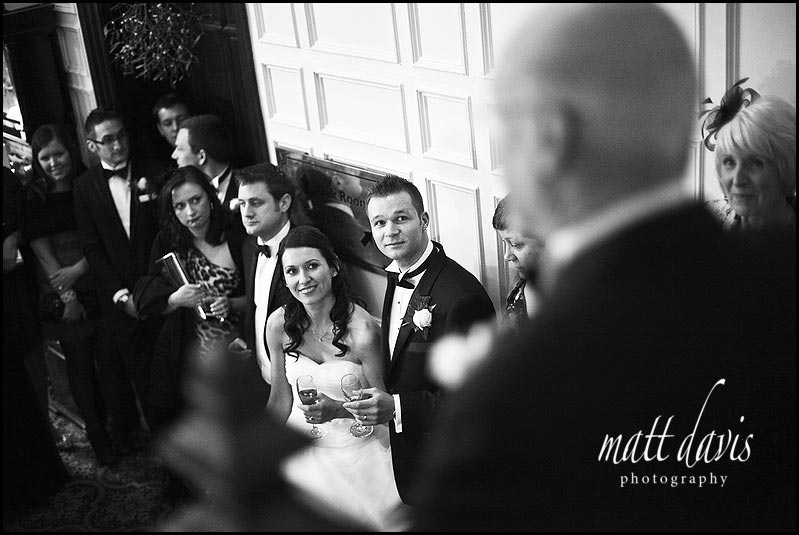 wedding speech in entrance hall at Dumbleton Hall