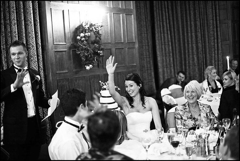 Dumbleton hall wedding speeches with brides hand in air