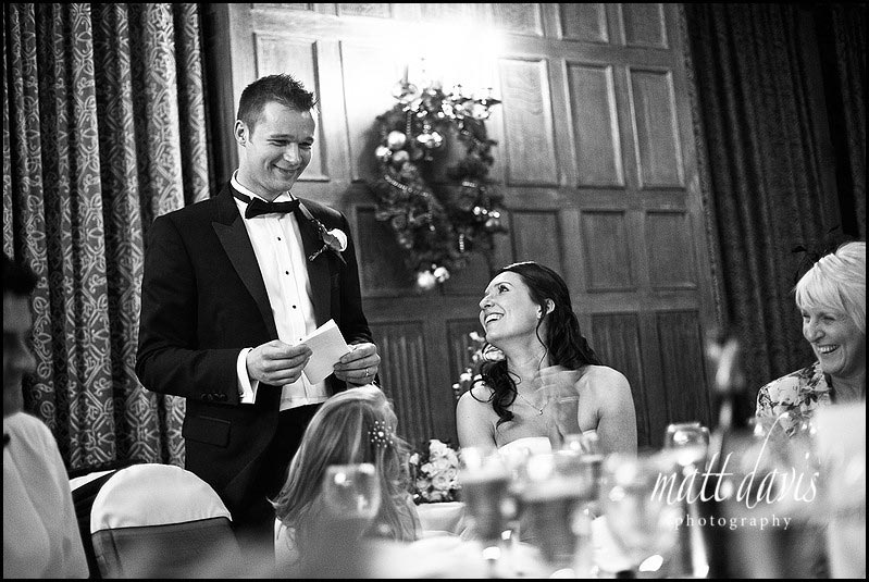 Dumbleton hall wedding speeches with bride smiling