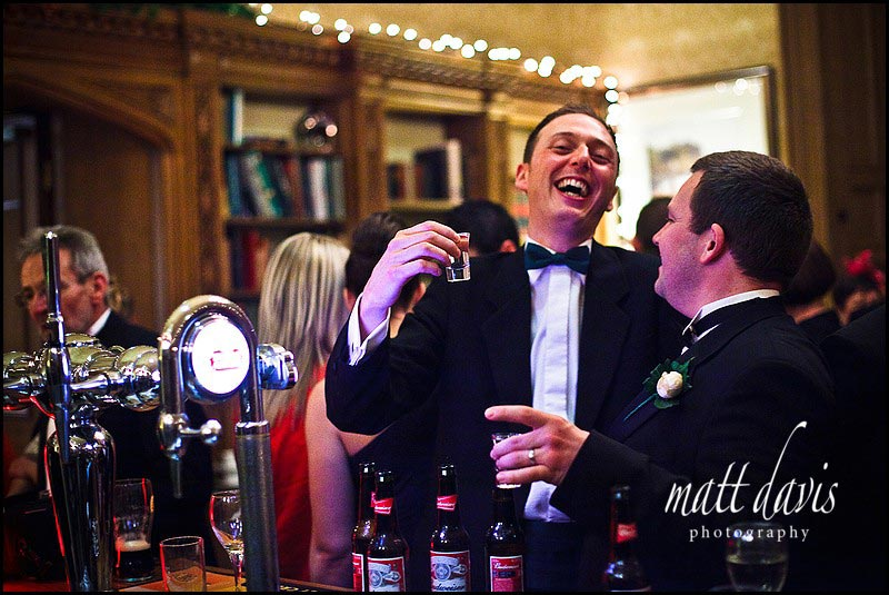 Drinks reception in bar at Dumbleton hall wedding