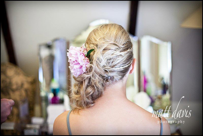 Side swept wedding hair with flower