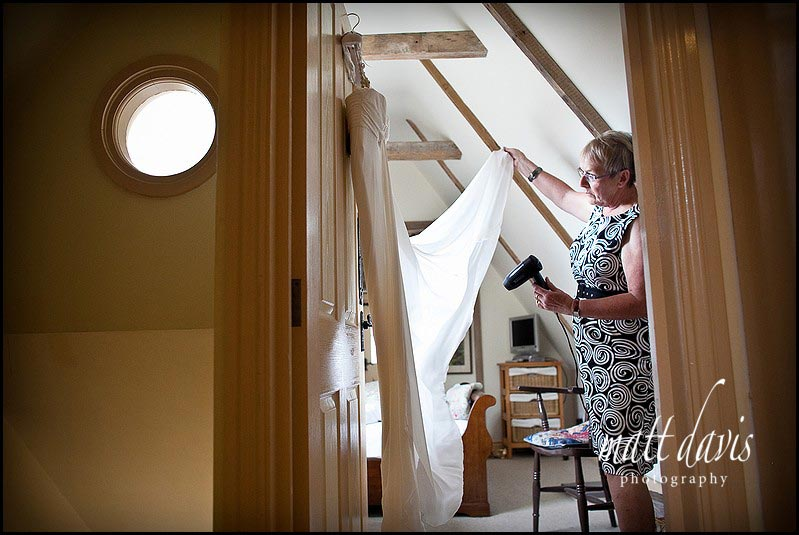Mum getting creases out of wedding dress
