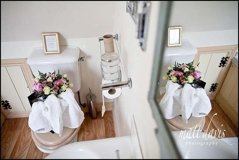 Wedding flowers on toilet before the wedding
