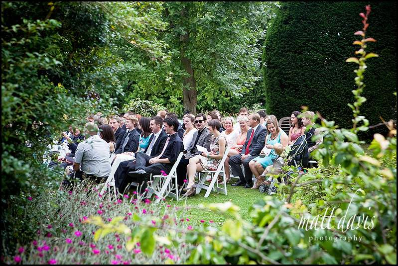 Guests at an outside wedding ceremony at Friars Court