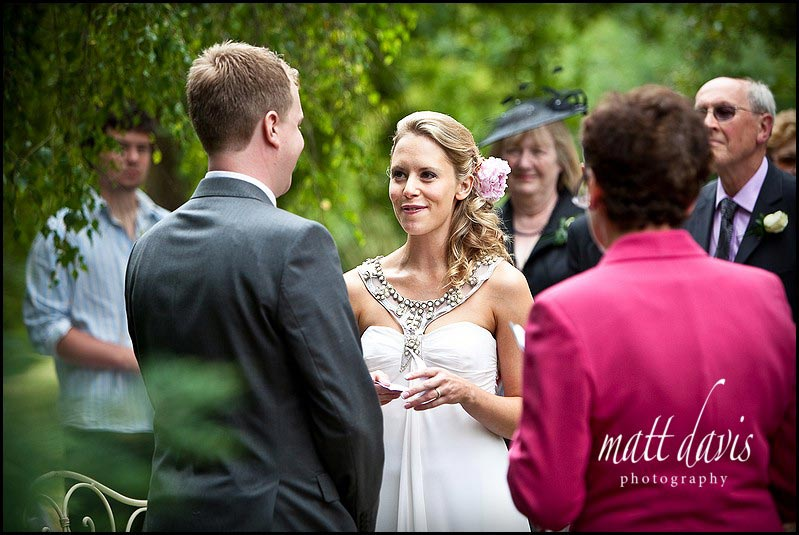 Photo of bride during an outdoor wedding ceremony at Friars Court