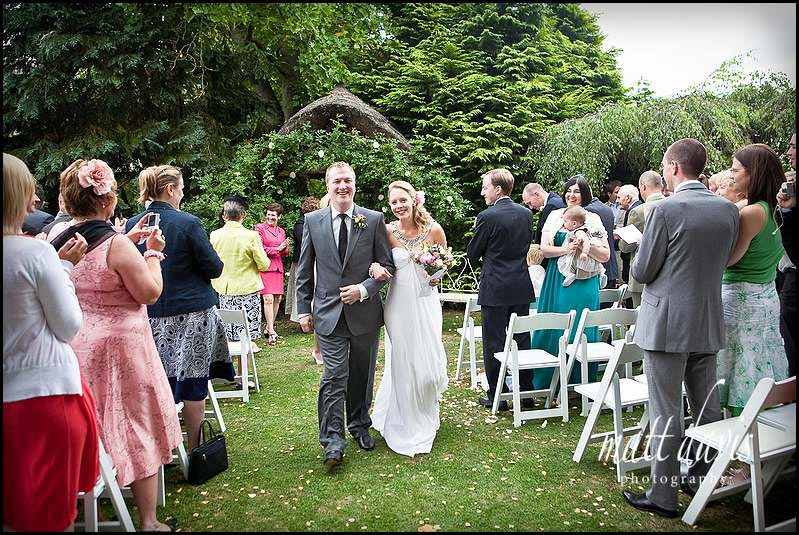 An outdoor wedding ceremony at Friars Court