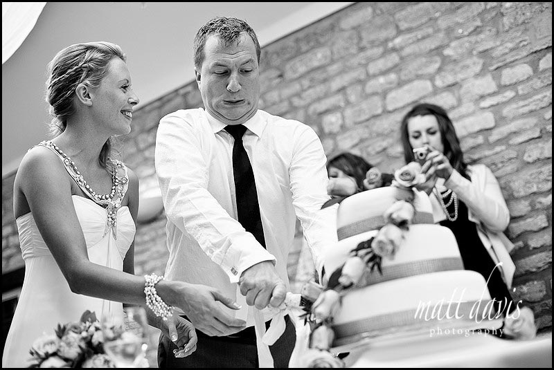 Documentary Wedding Photography of cake cutting