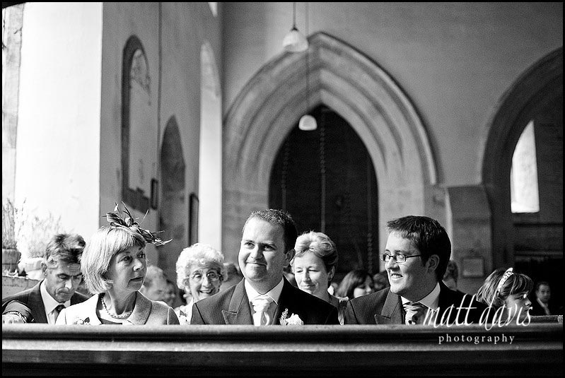 Groom before wedding at St Mary's Church, Swerford, Oxfordshire