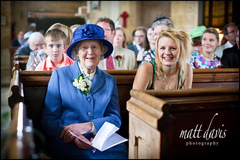 Wedding guests at St Mary's Church, Swerford, Oxfordshire
