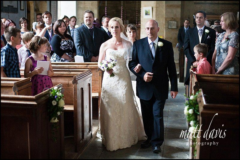 brides entrance at wedding at St Mary's Church, Swerford, Oxfordshire