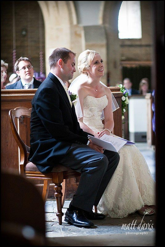 married couple at a wedding in St Mary's Church, Swerford