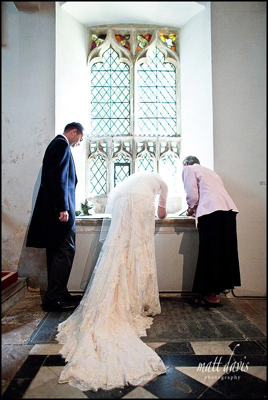 back of wedding dress during signing of the register