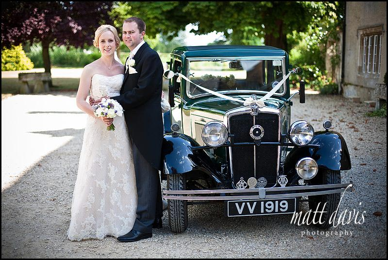 wedding photos outside Friars Court with vintage wedding car