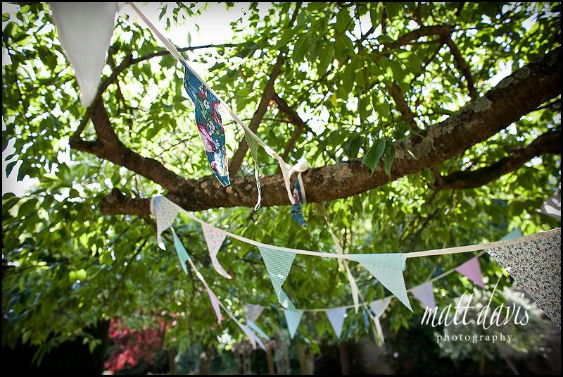 Bunting in the trees at Friars Court wedding