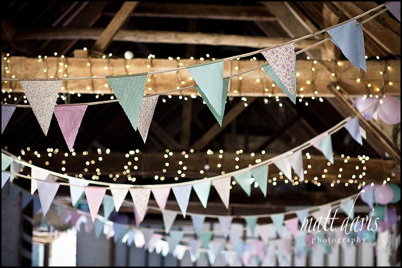 bunting hung in the barn at Friars Court wedding