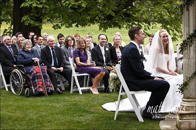 Guests watching outdoor wedding ceremony