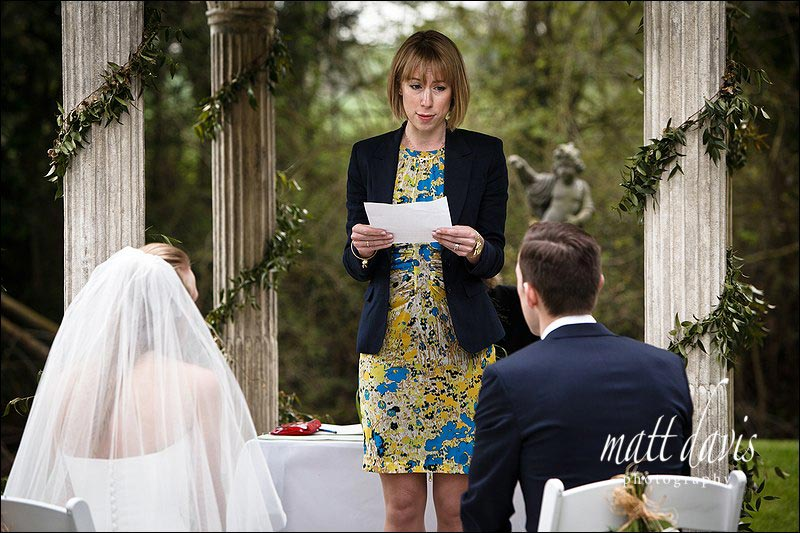 A wedding reading at outdoor wedding ceremony