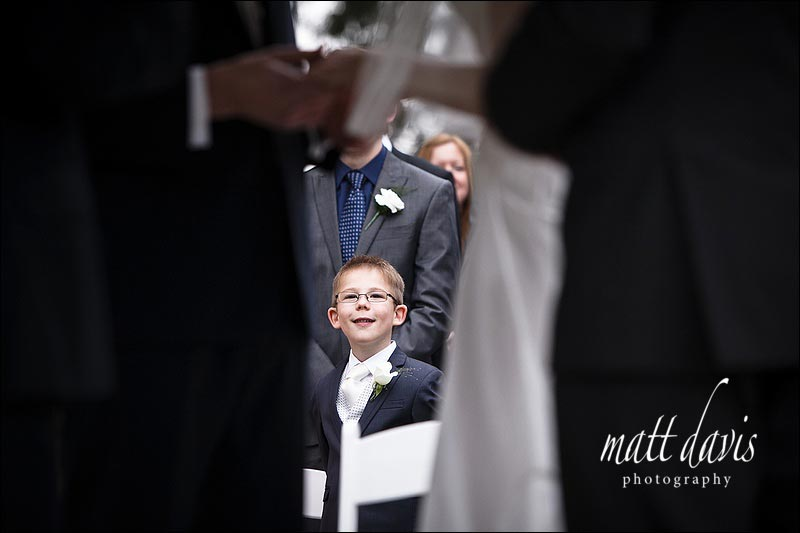 Young ring barer at wedding watching the vows