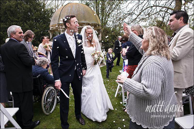 confetti at outdoor wedding ceremony Ardington House