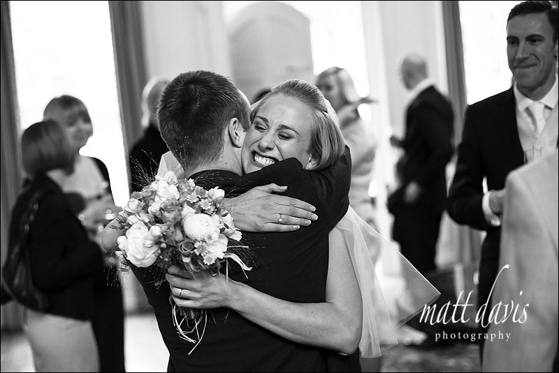 bride hugging brother at Ardington House wedding
