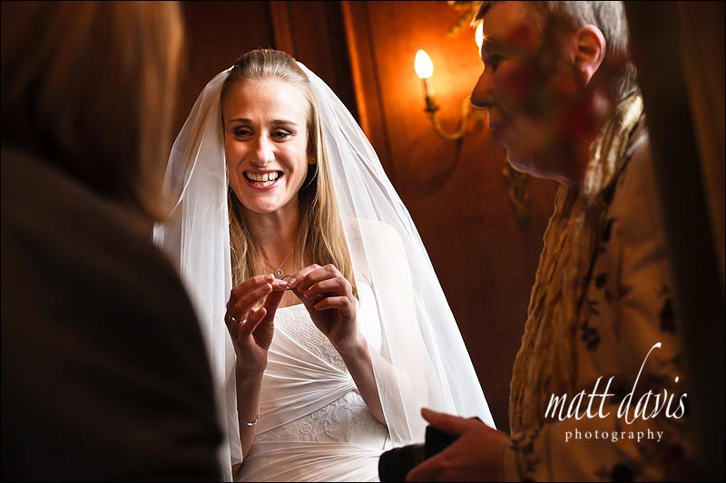 Bride with wedding ring in hands showing wedding guests
