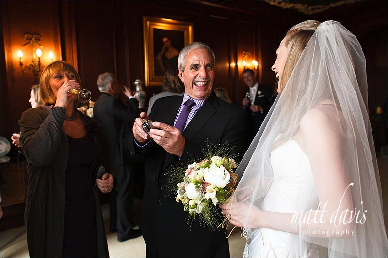 Bride laughing with wedding guests at Ardington House