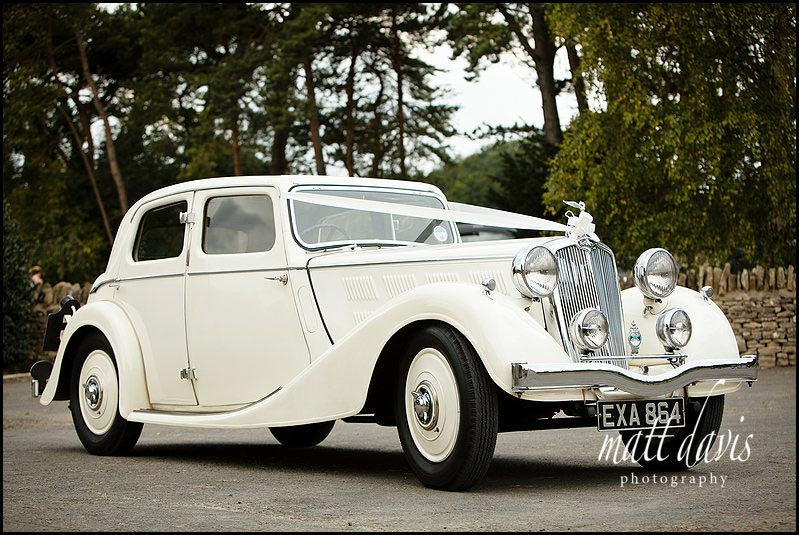 cream vintage wedding car