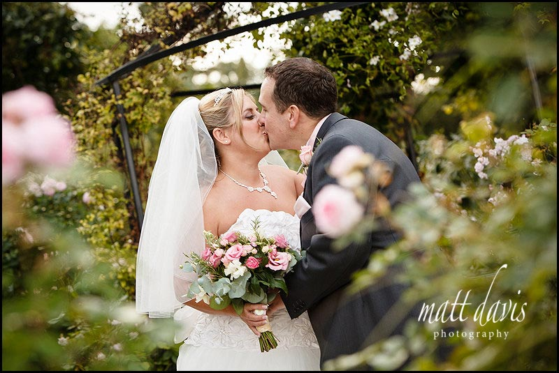 wedding couple kissing at Kingscote Barn wedding