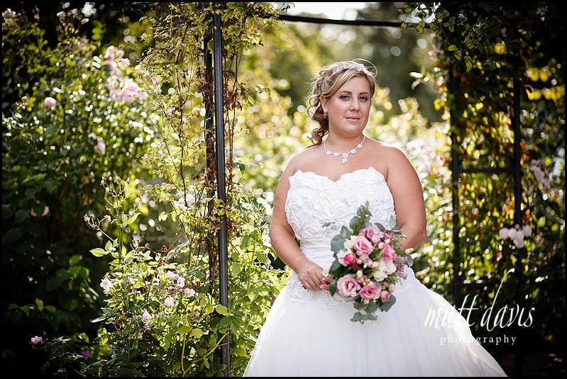 bride with flowers at Kingscote Barn weddings
