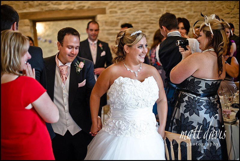 wedding couple welcomed for dinner at a Kingscote Barn wedding