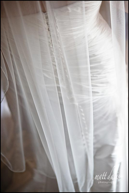Back of wedding dress with veil over buttons