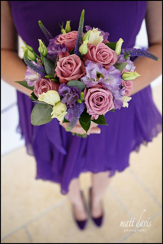 Purple bridesmaid dresses and flower bouquet