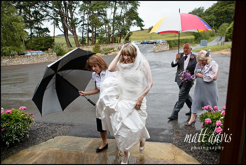 wet wedding photos at Kingscote Barn