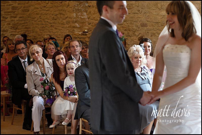 guests watching wedding ceremony at Kingscote Barn