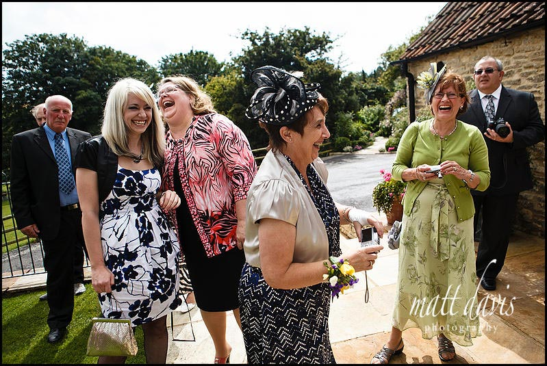 guests laughing at a Kingscote Barn wedding reception