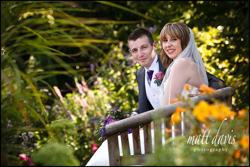 Kingscote Barn wedding photos in the small garden