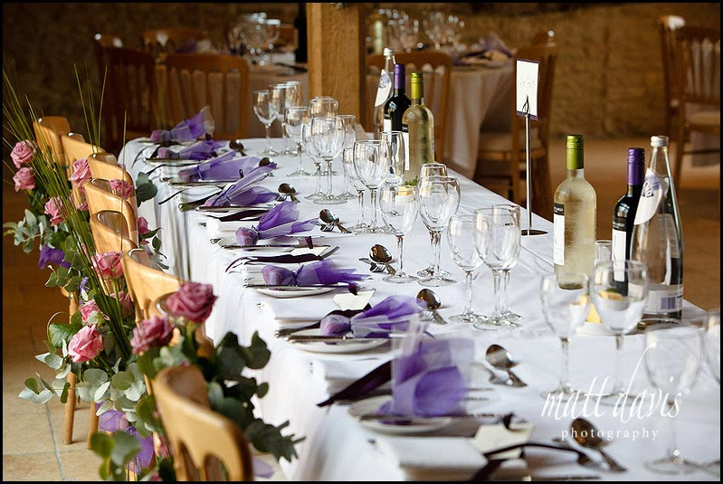 Wedding table settings with purple theme