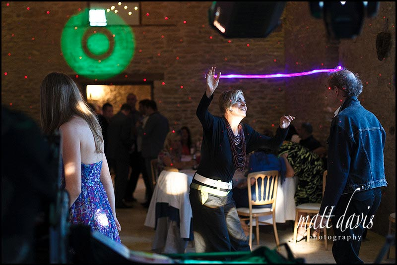 Dance floor photo at Kingscote Barn with laser beams