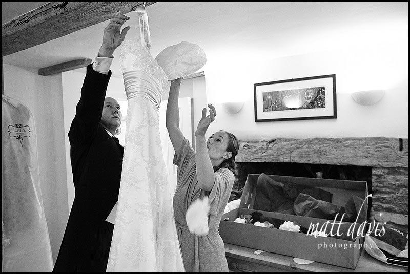 bride removing padding from wedding dress