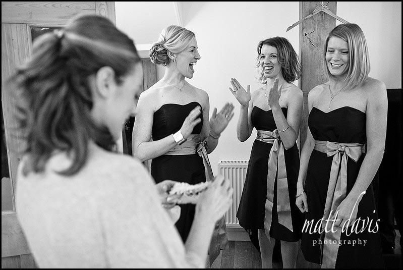 wedding garter presented by bridesmaids