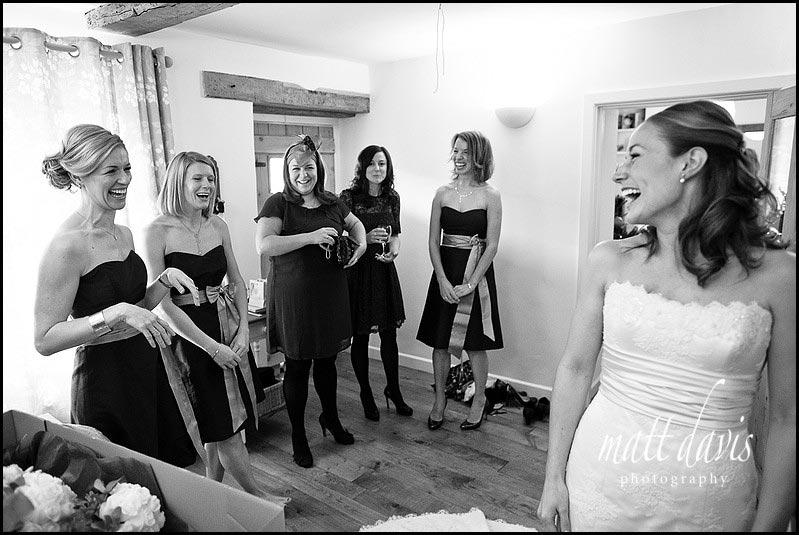 dark bridesmaid dresses with light sash for a winter wedding