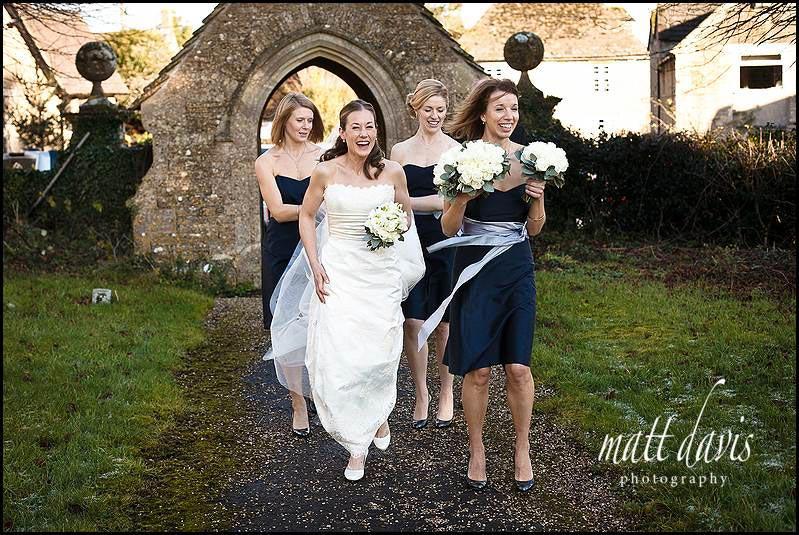 Dark blue bridesmaid dresses with silver sash