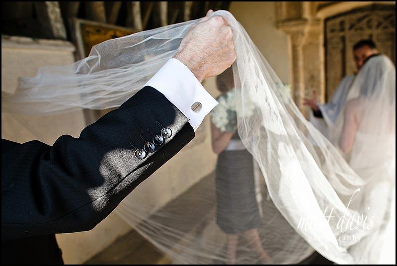 interesting wedding photo at Kington St Michael Church.