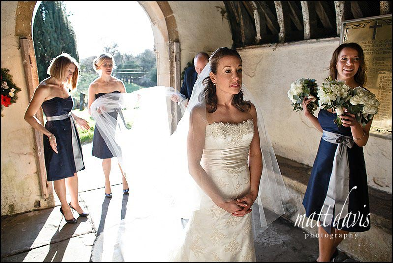 beautiful photo of bride waiting before ceremony at Kington St Michael Church.