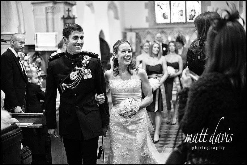 bride and groom leaving Kington St Michael Church
