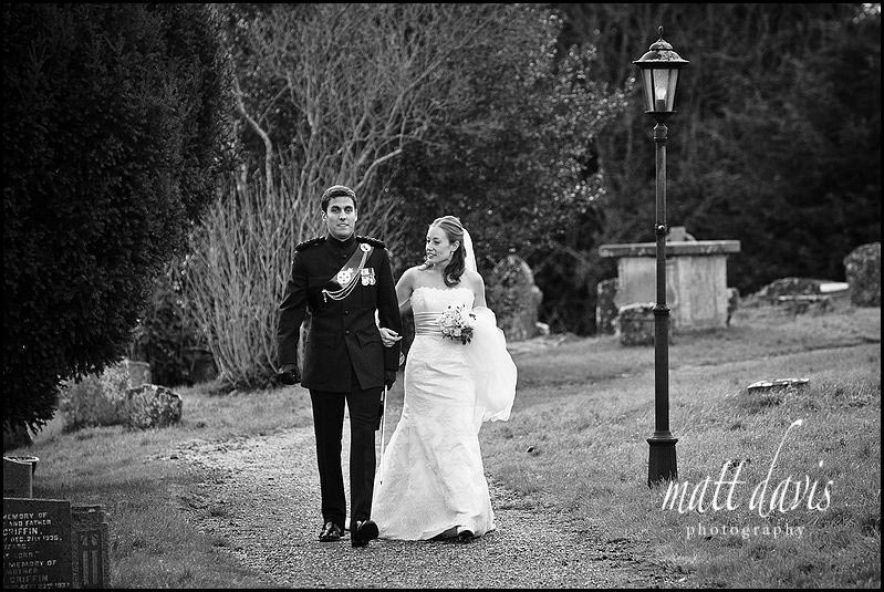 winter wedding photo in black and white at Kington St Michael Church.