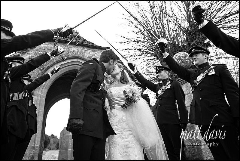 kissing under wedding guard of honour