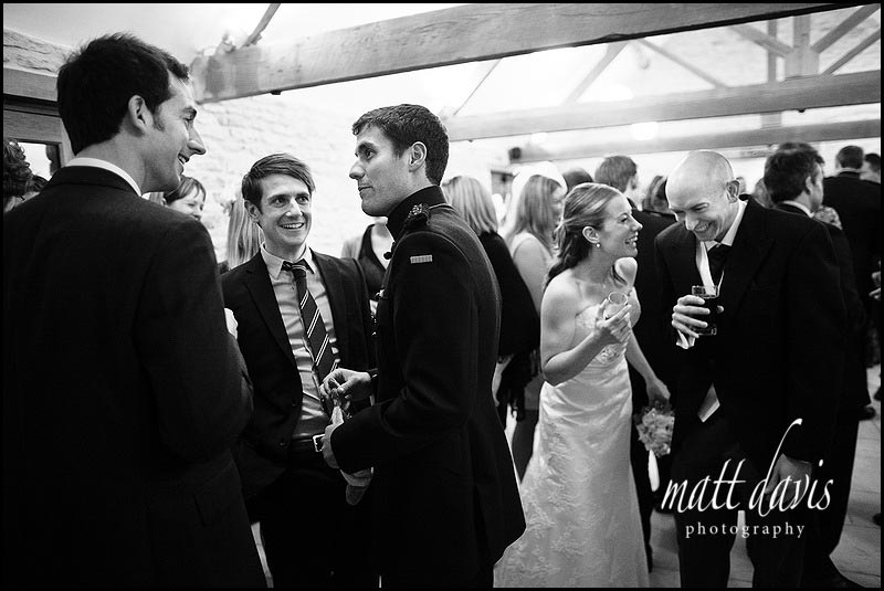 a winter wedding drinks reception at Kingscote Barn