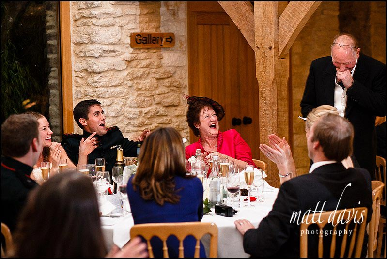 speeches during a winter wedding at Kingscote Barn